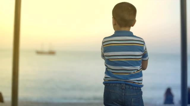 boy looking at ship video