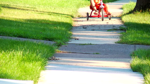 Boy low-riding on a Tricycle video