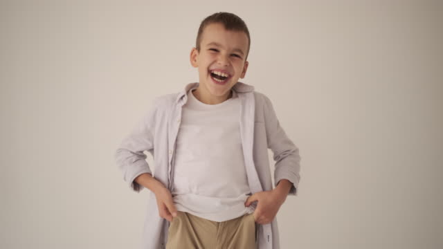 boy making vlog video over white background - solo bambini maschi video stock e b–roll