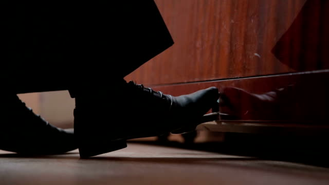 Boy musician foot is presses the piano pedal video