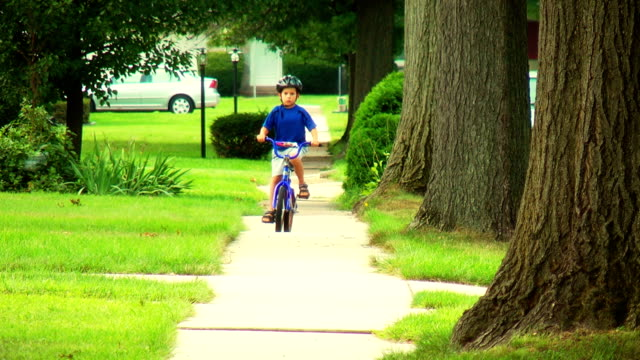 Boy on Bike, riding towards camera video