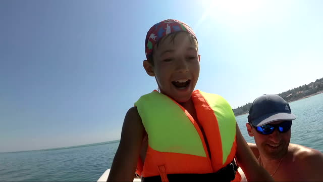 boy on pedal boat pulls off the hill into the sea video