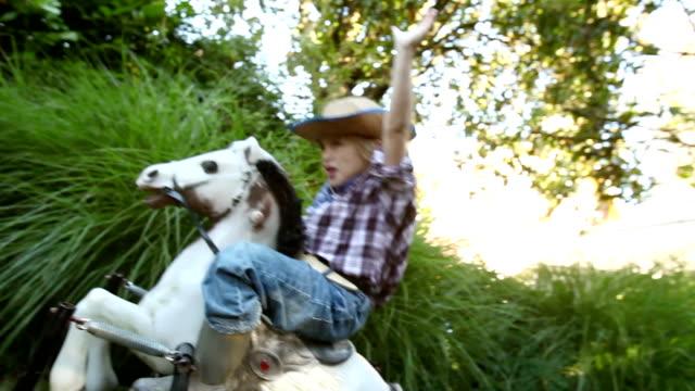 Boy on rocking horse video