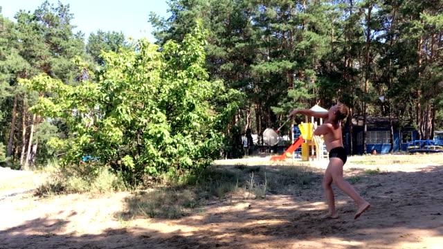 boy playing badminton outdoors video