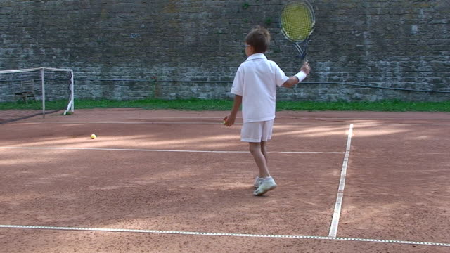 boy playing tennis - young singles stock videos and b-roll footage