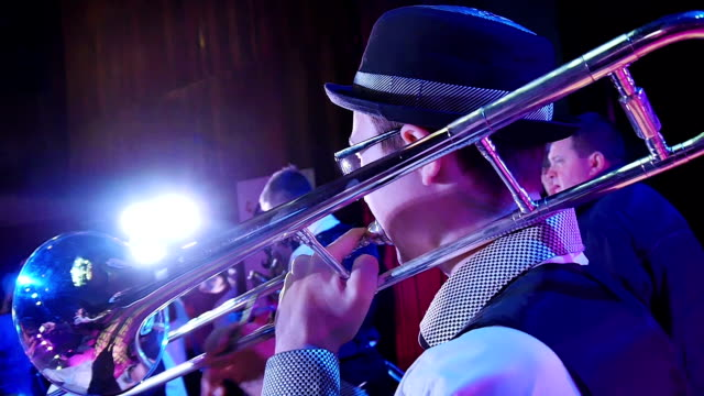 Boy playing the trombone Boy playing the trombone in the children's jazz orchestra organized group stock videos & royalty-free footage