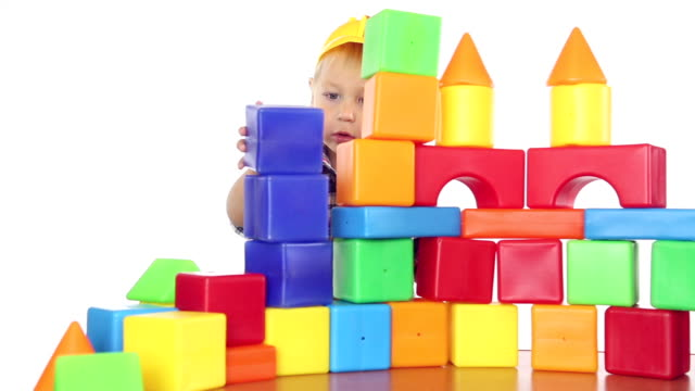 boy playing with blocks video