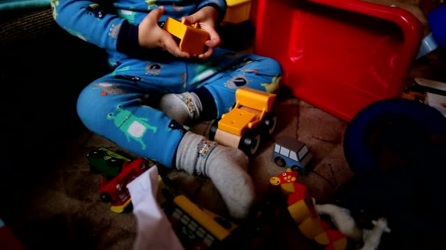 boy playing with his favorite toy cars - giocattolo video stock e b–roll