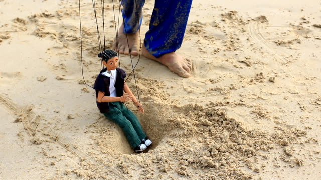 boy puppet play with sand boy puppet play with sand marionette stock videos & royalty-free footage