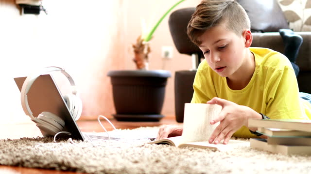 Boy reading book in his room