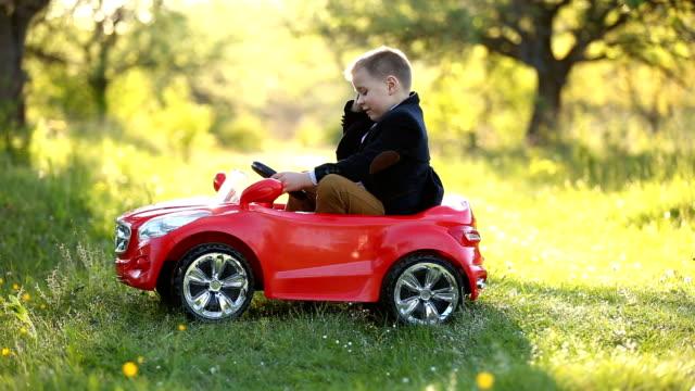 boy rides a red car video
