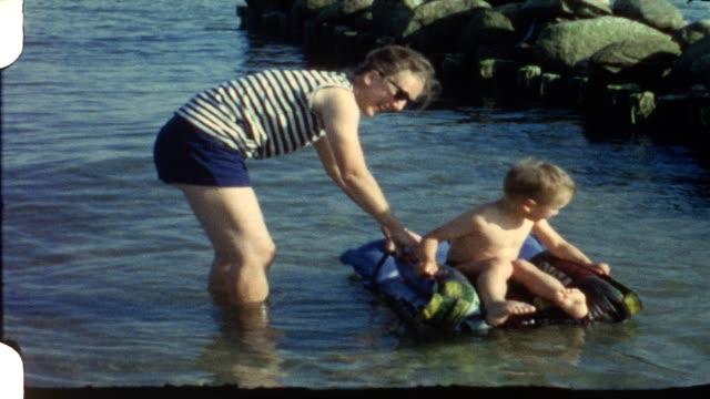 Boy rides on mattress (vintage 8 mm film) video