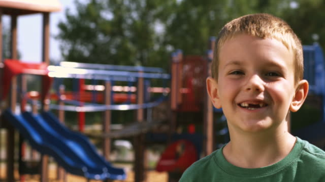 Boy Runs to Jungle Gym  one boy only stock videos & royalty-free footage