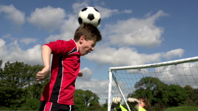 Boy scoring Soccer goal with Header - Kid's Football video