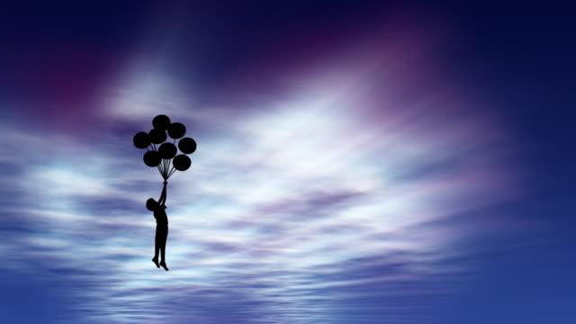 stockvideo's en b-roll-footage met jongen silhouet houdt ballonnen die hem tillen tot een prachtige hemel met zonnestralen schijnt door de wolken - gefabriceerd object