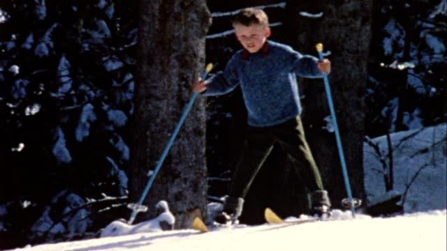Boy skiing downhill (vintage 8mm film)