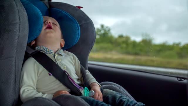 pojke sova i en bil - baby sleeping bildbanksvideor och videomaterial från bakom kulisserna