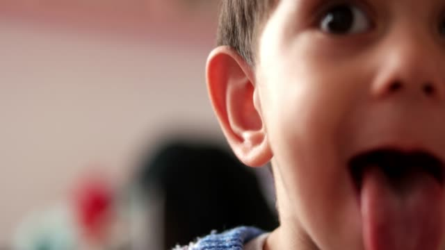 Boy Sticking Tongue Out Boy Sticking Tongue Out mouth open stock videos & royalty-free footage