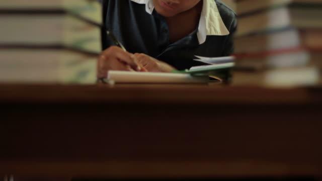 PORTRAIT: Boy studying video