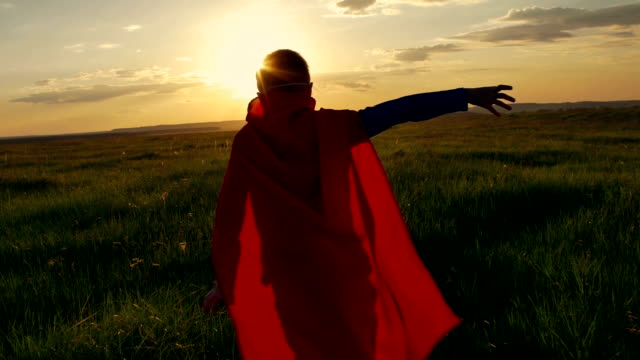 boy superhero in a field at sunset - super hero stock videos & royalty-free footage