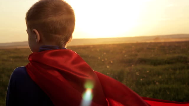 boy superhero in a field at sunset video
