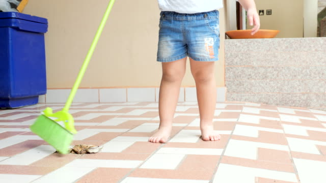 Boy sweep the floor