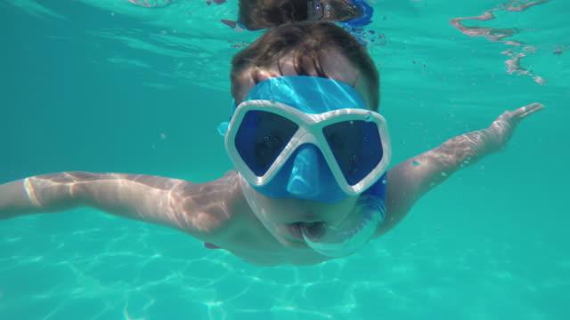 Boy swimming underwater video