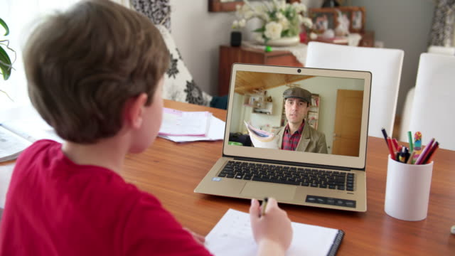 Boy taking online courses in living room video