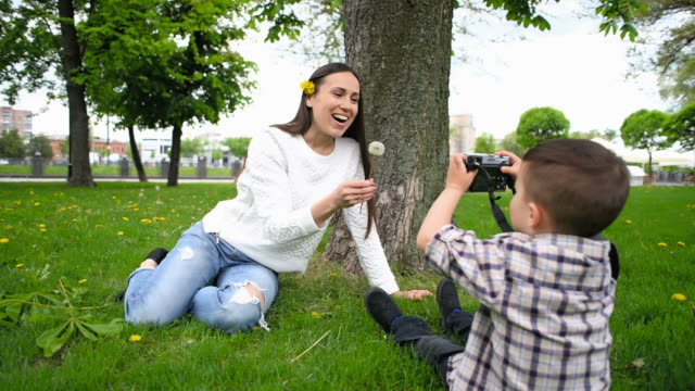 boy taking photo his mother video