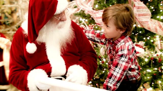 boy talking to santa - jultomte bildbanksvideor och videomaterial från bakom kulisserna