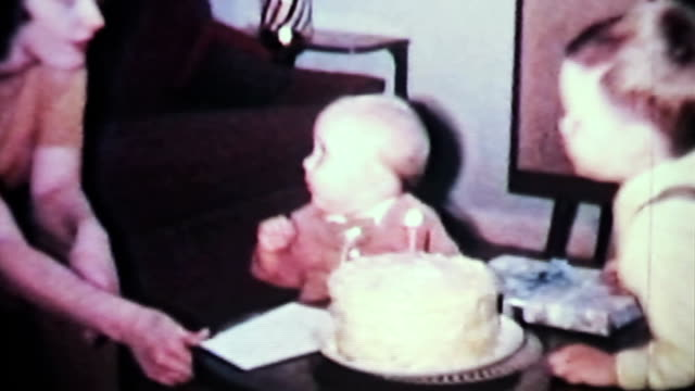 boy tries to blow out birthday candles-1965 vintage 8mm film - 移動圖像 個影片檔及 b 捲影像