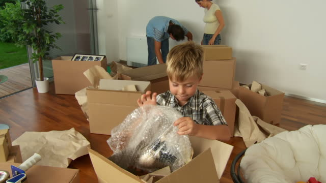 HD: Boy Unpacking Toys In New Home video