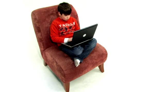 Boy Uses Laptop video
