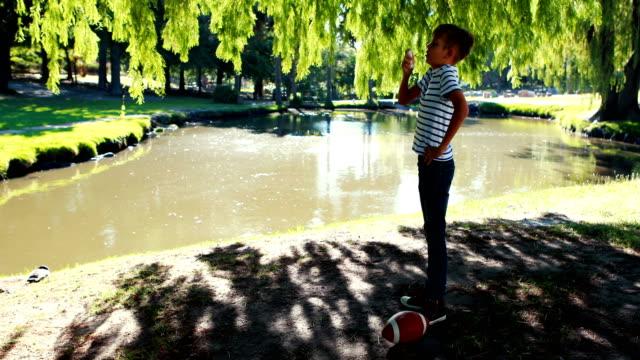 Boy using asthma inhaler in park video