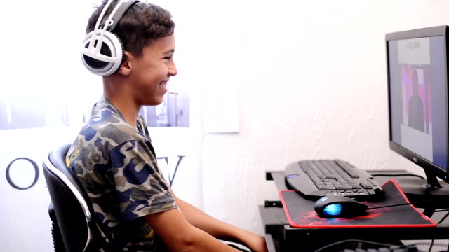 Boy using computer video