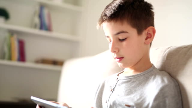 Boy using digital tablet  at home video