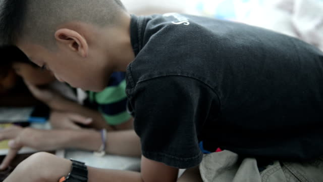 Boy Using Digital Tablet video