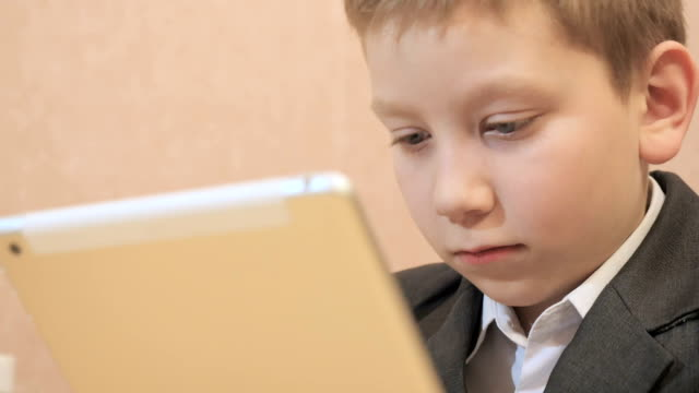 Boy using tablet computer and thumb up video