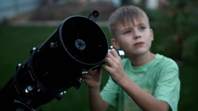 boy using telescope - astronomia video stock e b–roll