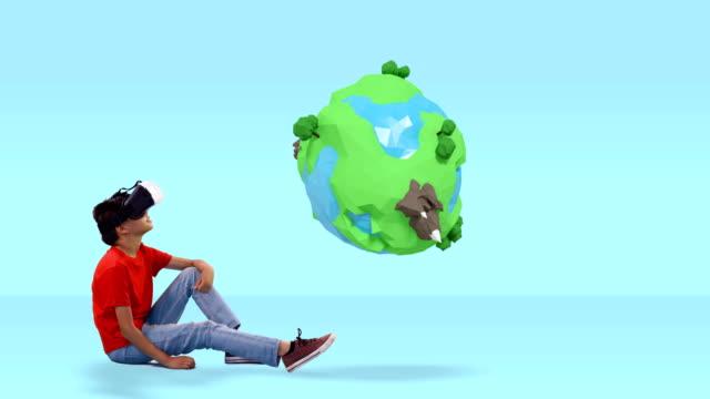 boy using virtual reality headset with digitally generated travel icons 4k - pesche bambino video stock e b–roll