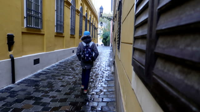 Boy walking alone on a paved street with a backpack - Stock Video Kid going alone to school hungary stock videos & royalty-free footage