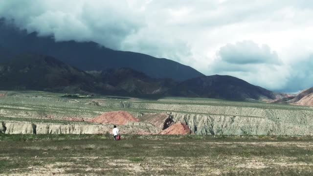 Boy Walking Home After School In Mountains In The Altiplano. Boy Walking Home After School In Mountains In The Altiplano. Full HD. pacific islands stock videos & royalty-free footage