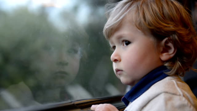 Boy watching out of the train video