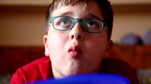 boy watching tv and enjoy with snacks video