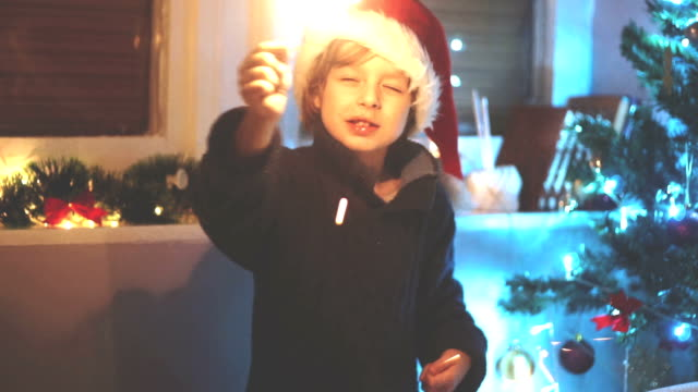 boy with christmass sparkle video