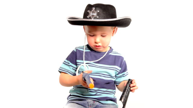 Boy with cowboy hat and gun video