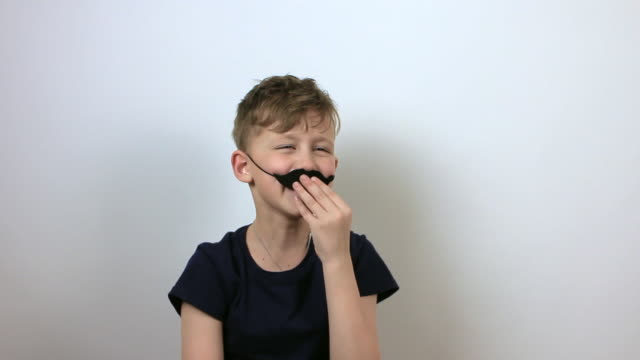 boy with false moustache having fun. - april fools day stock videos and b-roll footage