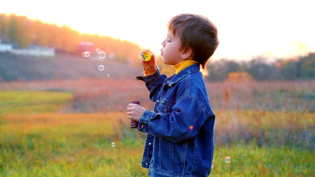 Boy with soap bubbles video