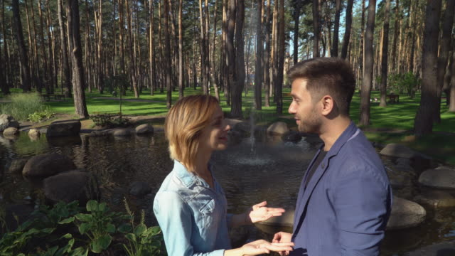 boyfriend and girlfriend at the open air talking and dispute - debate стоковые видео и кадры b-roll