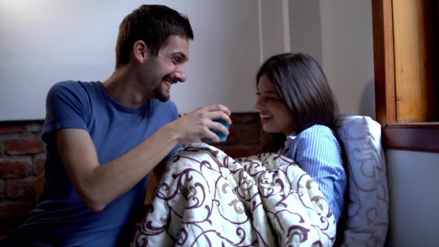 boyfriend brings tea to his sick girlfriend - miroslav mitic stock videos and b-roll footage